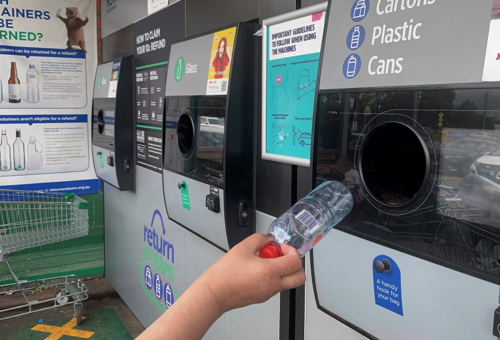 A customer participating in the container deposit scheme in NSW. Return and Earn.
