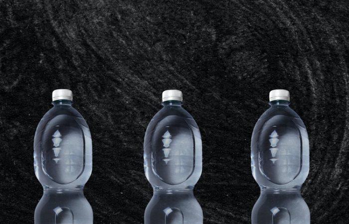 three plastic water bottles