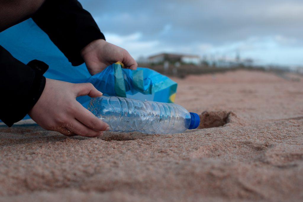water bottle on the beach which questions its sustainability
