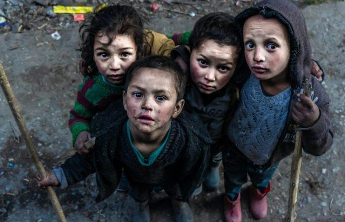 Sick looking children in slum setting with sanitation issues