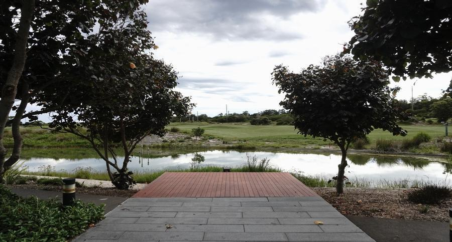 green space with a lake for the community