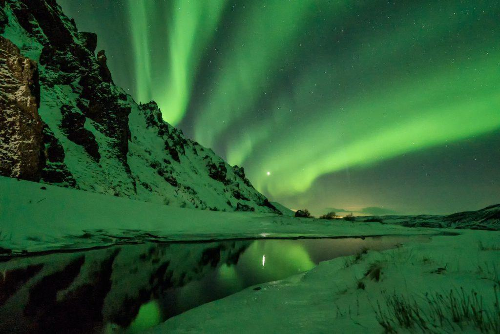 View of Northern Lights from a sustainable city