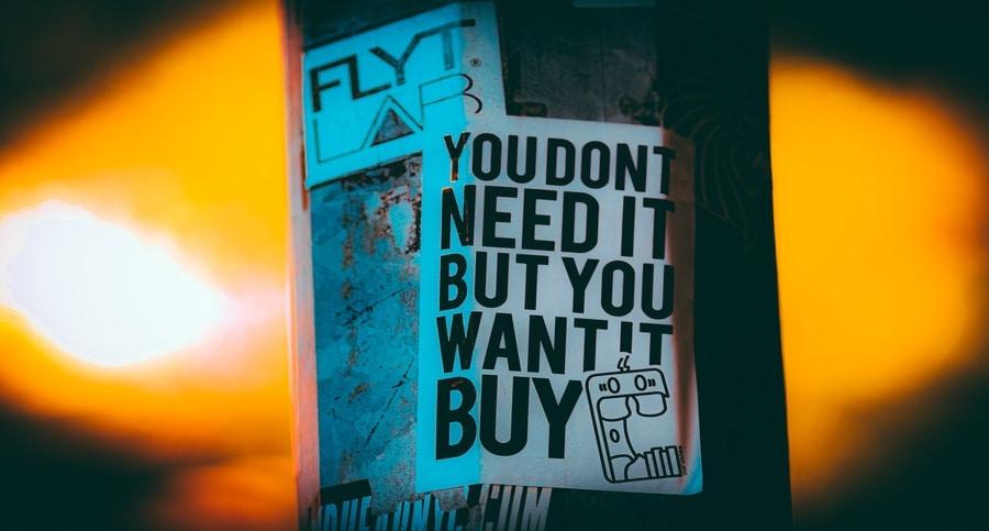 Sign highlighting consumerism excessive consumption